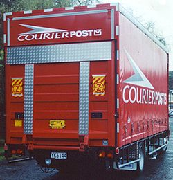 Curtainsider with tail lift acting as door